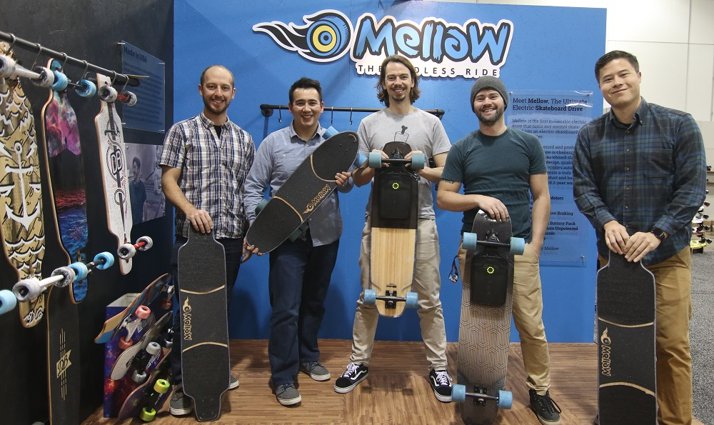 mellow-electric-skateboard-SIA SNOW SHOW group shot-banner